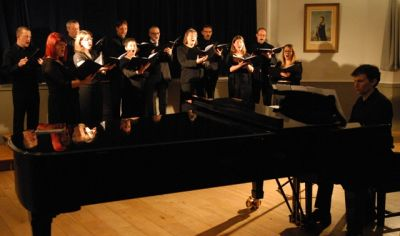 Vocal ensemble 'Eight in a Bar' with director Bernard West